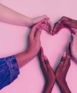 A picture of the hands of 4 people of different races. The hands are arranged to construct a heart. People with heart disease are prone to harmful effects of cellphone radiation.