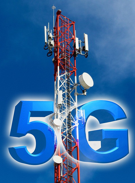 A picture of a 5G tower, with a big blue 5 and a G on either side of the tower.