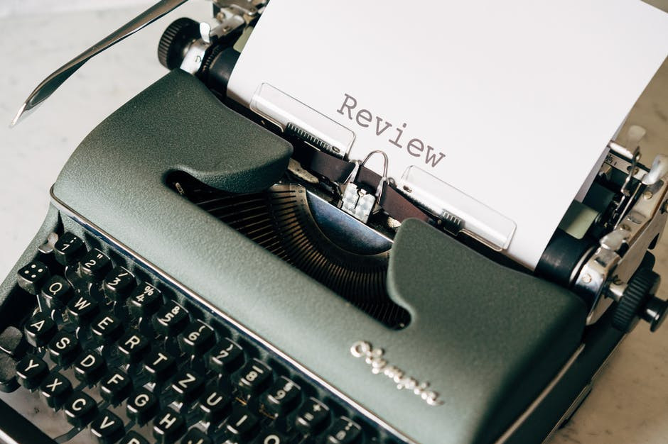 A typewriter being used to type a Review, like this article.