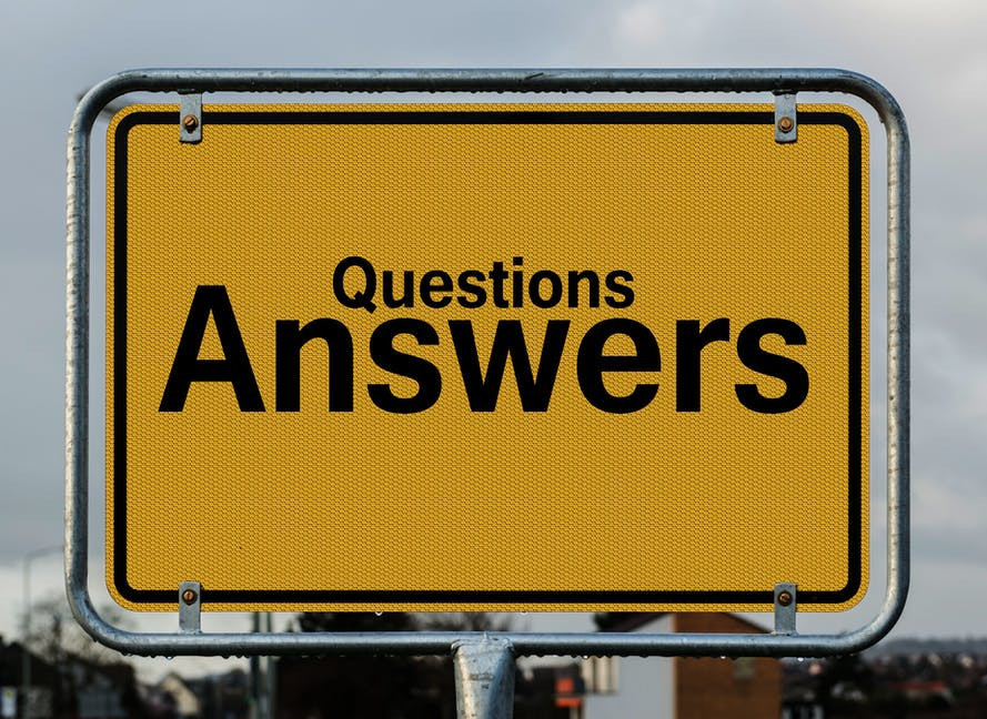 A sign saying Questions; Answers.
